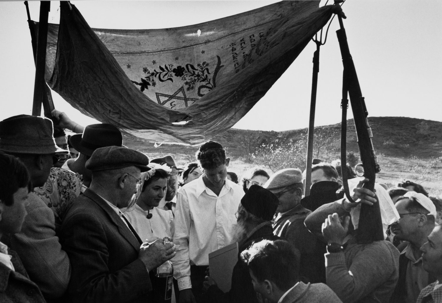 Wedding under an improvised wedding canopy made with guns and pitchforks, Israel