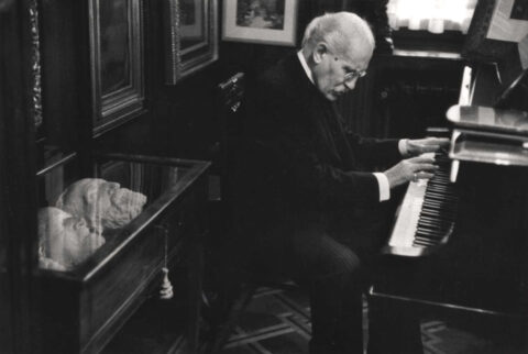 Arturo Toscanini playing piano in his home, Italy